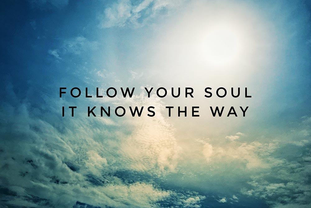 """Follow your soul it knows the way"" typed on a blue sky background."