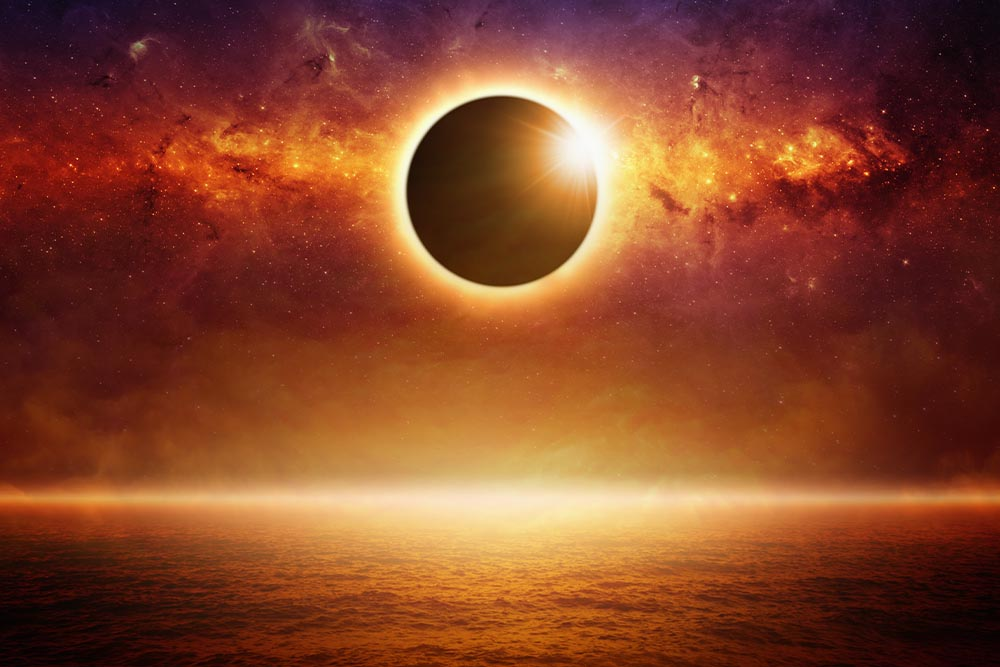 Superimposed image of an eclipse on a space background above the horizon