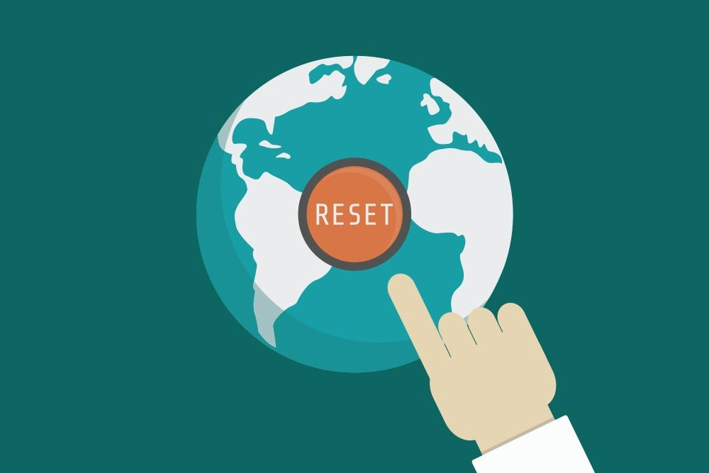 Vector graphic of a hand reaching for a reset button overlaid on top of the world.