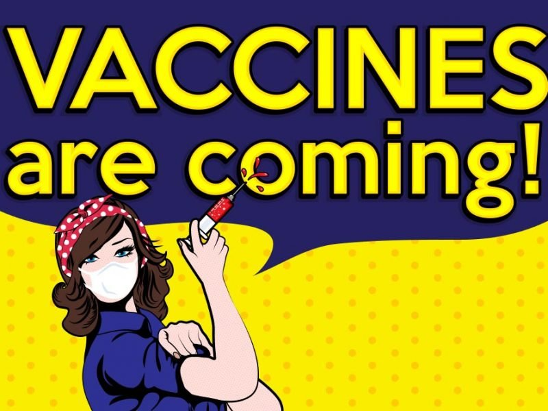 """Cartoon image of Rosie The Riveter styled character with a mask on her face and syringe in her hand. There's a large speech bubble above that says """"vaccines are coming!"""""""