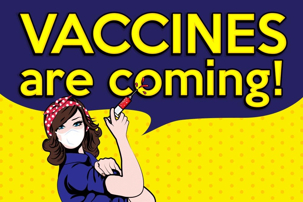 "Cartoon image of Rosie The Riveter styled character with a mask on her face and syringe in her hand. There's a large speech bubble above that says ""vaccines are coming!"""