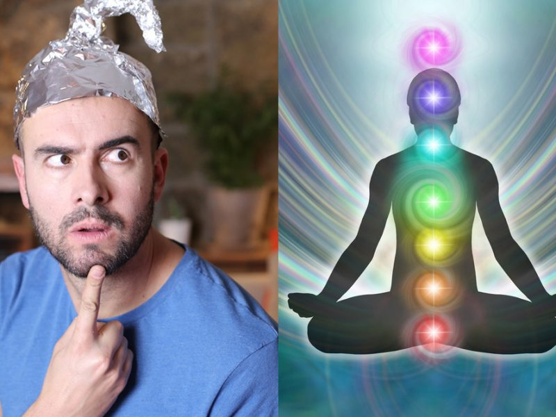 Image of a conspiracy theorist with tinfoil hat next to silhouette of chakras by color diagram