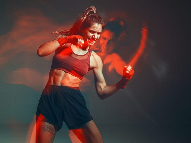 Athletic woman boxing