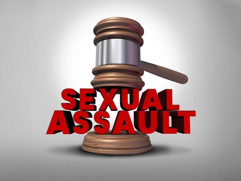 Judge's gavel coming down on large red block letters that say sexual assault