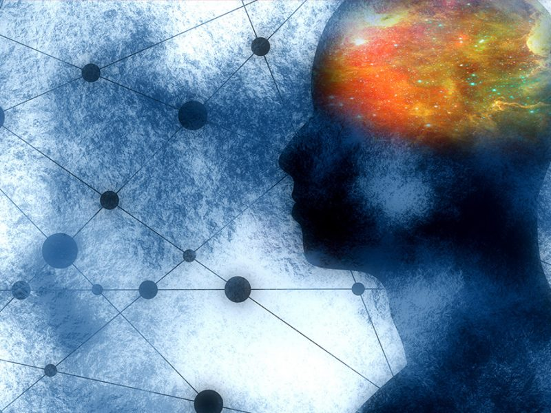 Abstract image of a person's blurred silhouette with geometric figures in the background and the brain lit up like a heat map with a galaxy design in it
