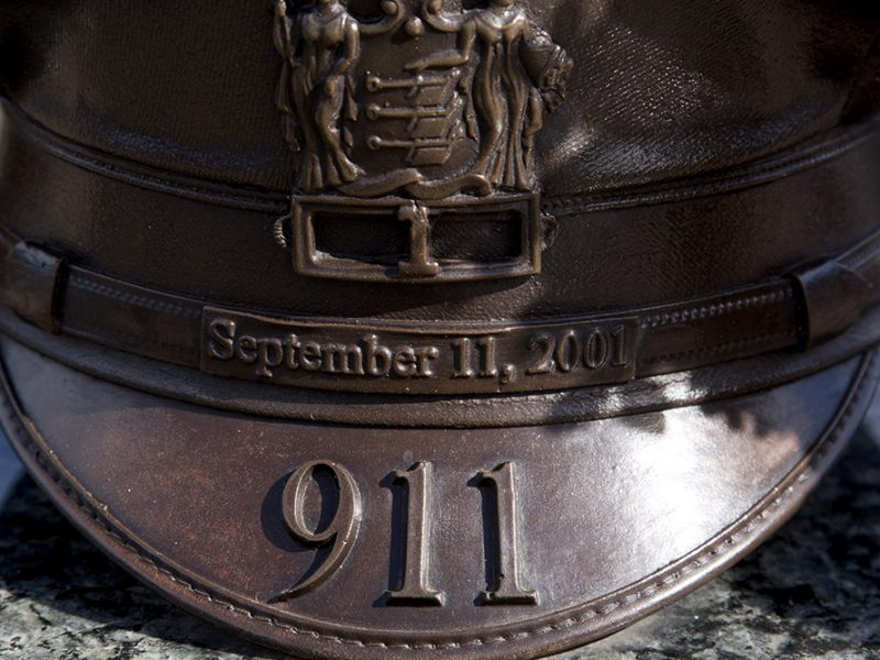 Bronze monument of a military hat with September 11, 2001 and 911 on it commemorating the day