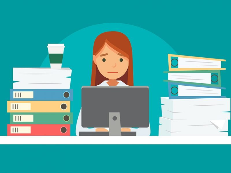 Vector image of a woman frowning at her computer desk with piles of books and binders on either side of her