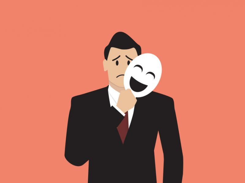 Vector image of a man in a suit frowning while moving a happy mask away from his face